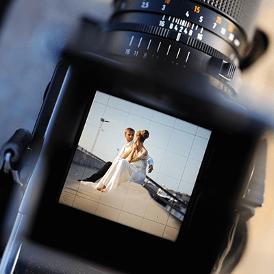Wedding couple caught in camera viewfinder